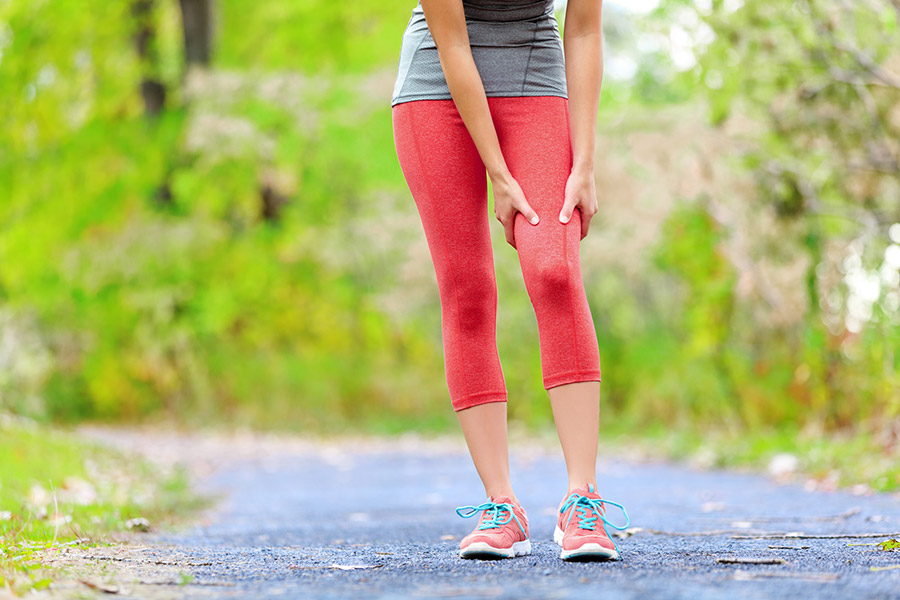 Wat zijn de symptomen van spierpijn in de bovenbenen